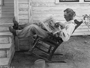 "Farmer reading ""The Progressive Farmer"""